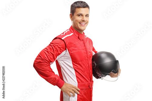 Obraz na plátně Racer holding a helmet and smiling