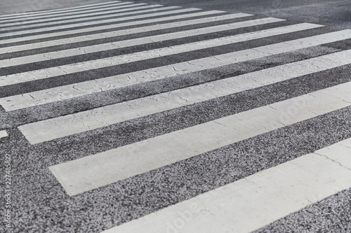 Wallpaper Mural road surface marking and traffic concept - close up of crosswalk