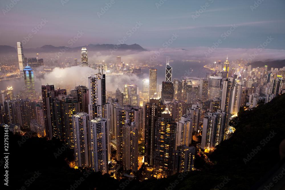 High angle view of illuminated cityscape of Hong Kong, China