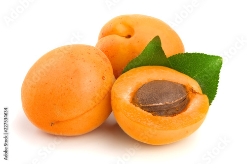 Obraz na plátně Apricot fruits with leaves isolated on white background macro