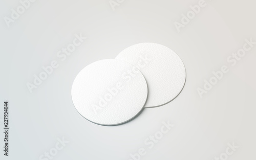 Blank white two beer coasters mockup set, isolated, 3d rendering. Blank round rug for beverage mock up. Empty bottle coaster lying. Circular can mat design.