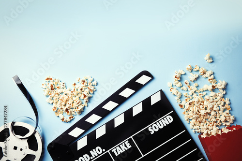 Flat lay composition with popcorn and space for text on color background. Cin...