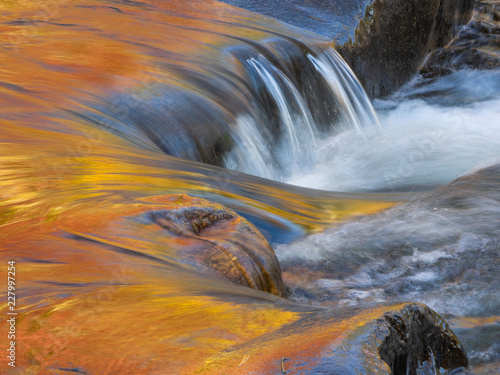 Canvas Print Small waterfall on mountain brook
