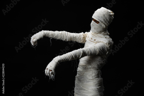 Tablou Canvas Studio shot portrait  of young man in costume  dressed as a halloween  cosplay of scary mummy pose like a zombie acting on isolated black background