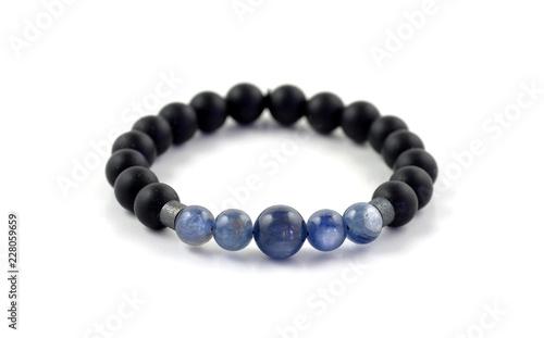 Fotografía Black onyx and kyanite stone bracelet isolated on white background