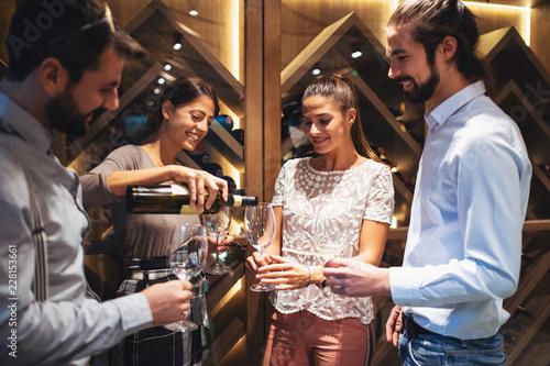 Happy couples taste wine in the restaurant