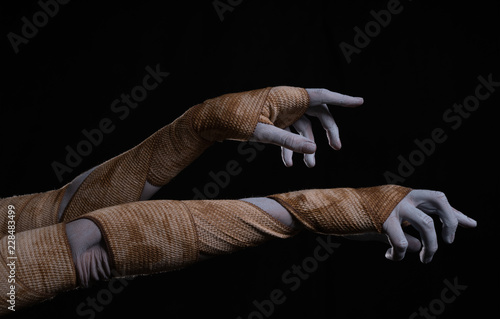 Photographie Creepy mummy stretching hands wrapped in bandages