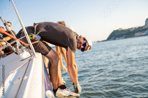 Fototapeta Team athletes Yacht training for the competition
