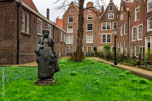 AMSTERDAM, NETHERLANDS - APRIL 9, 2018: Begijnhof is one of the oldest inner courts in the city of Amsterdam. A group of historic buildings, mostly private dwellings, centre on it.