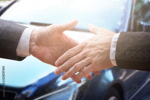 Obraz na płótnie Two Businesspeople Shaking Hands