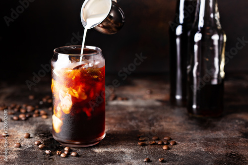 Leinwand Poster Cold brew iced coffee in glass bottles