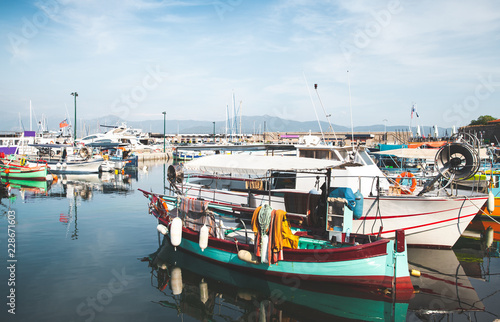 Old fishing boats are moored in port