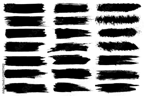 Fototapeta Set of different ink paint brush strokes isolated on white background