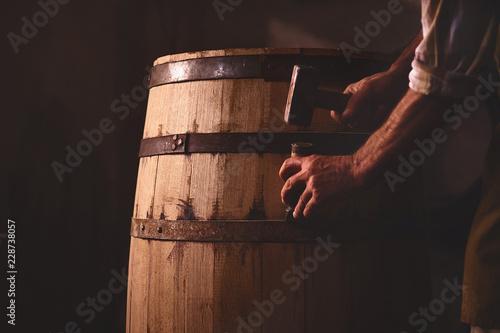 Billede på lærred Wooden Barrels in a cooperage, barrel workshop