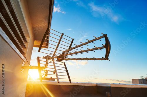 directional antenna for digital television broadcasting DVB-T over sunset Fototapeta