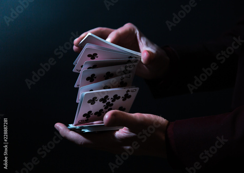 magician hands with playing...