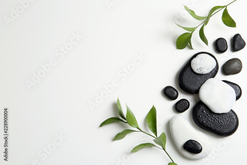 Photo Flat lay composition with spa stones and space for text on white background