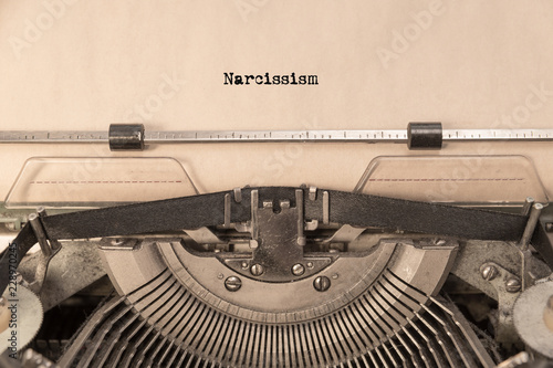Narcissism on a sheet of paper typed on a retro typewriter. writer, journalism.