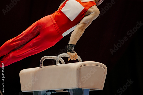 gymnast exercise pommel horse in competition artistic gymnastics
