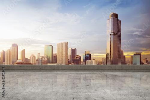 Fototapeta Empty rooftop floor with skyscrapers view