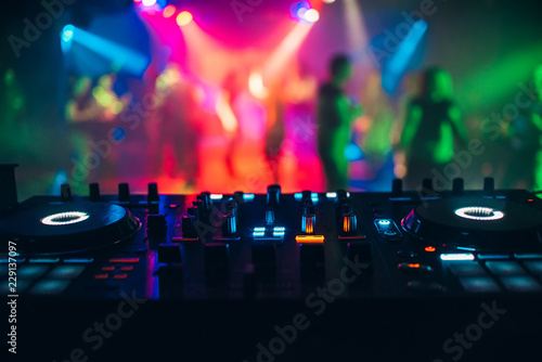 Fototapeta DJ mixer controller panel for playing music and partying in a nightclub
