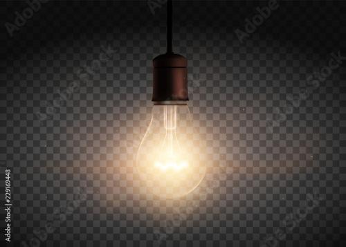 Fototapeta Template Edison retro light bulb is glowing in the dark