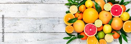 Leinwand Poster Fresh citrus fruits background