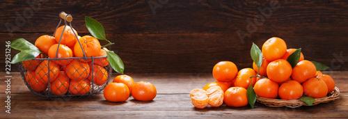 Fresh mandarin oranges fruit or tangerines on wooden table