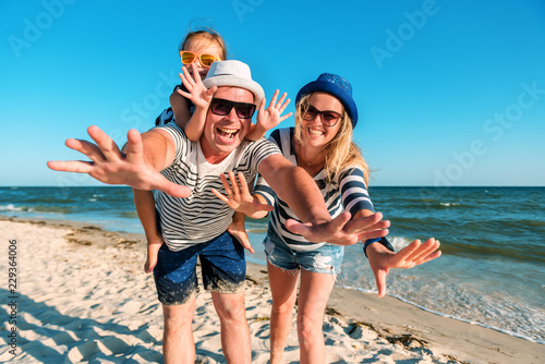 funny happy family on the beach