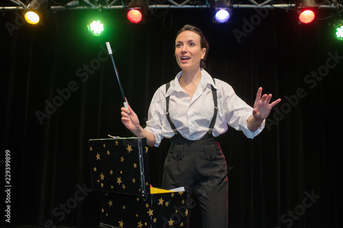female magician performing her show on stage