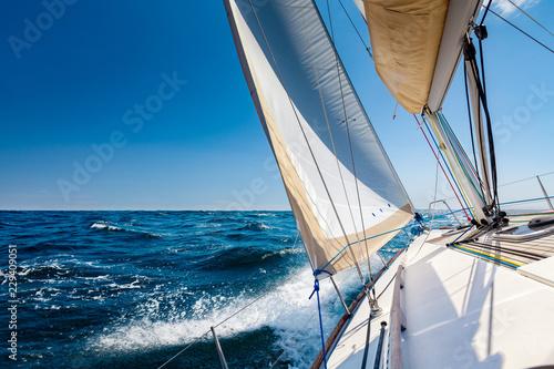 Stampa su Tela Sailing lboat at open sea in sunshine