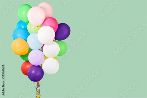 Bunch of colorful balloons on pastel background