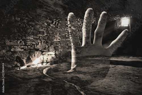 Valokuva Creepy hand in the dark cell, double exsposure