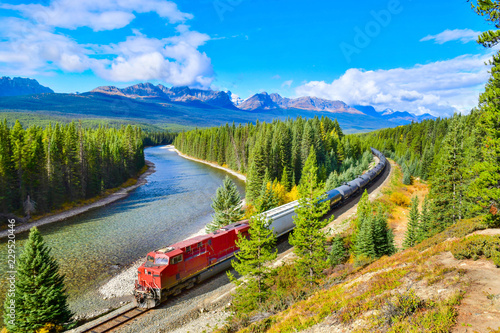 Train passing famous Morant's curve at Bow Valley in autumn ,Banff National Park, Canadian Rockies,Canada.