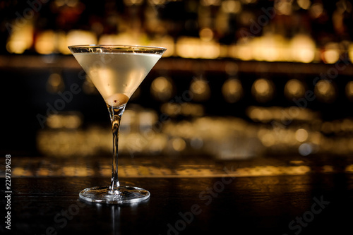 Elegant glass filled with tasty and fresh dirty martini drink