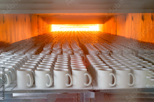 Vászonkép Porcelain ceramics mug mass production line oven burning