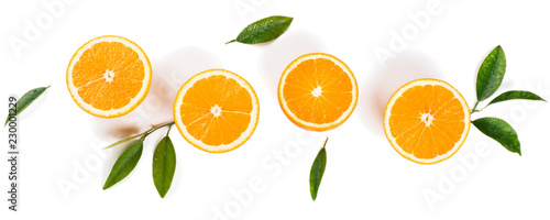 Half cut oranges and green leaves.