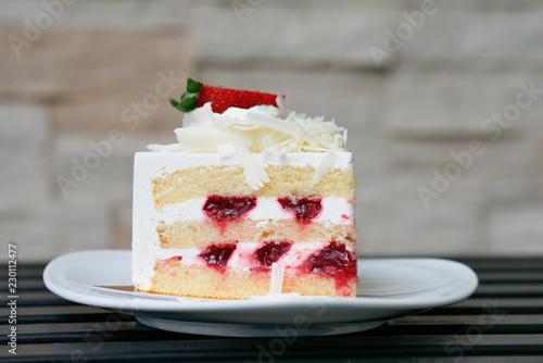 Wallpaper Mural Strawberry short cake on white plate.