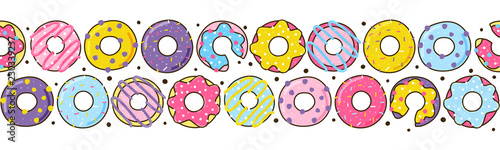 Foto Seamless border with color donuts