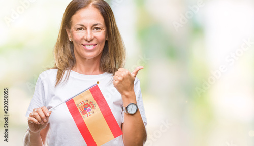 Photo Middle age hispanic woman holding flag of Spain over isolated background happy w