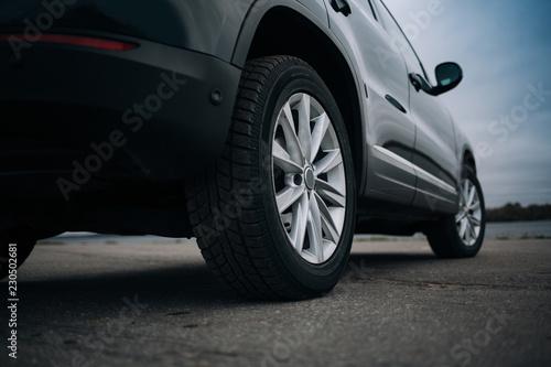Carta da parati Selective focus on blask SUV car rear wheel