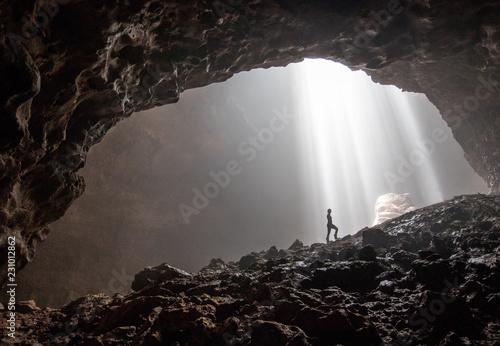 Murais de parede A silhouette inside the beautiful cave Goa Jomblang in East Java, Indonesia