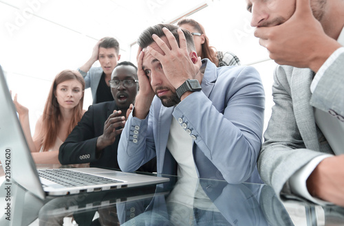 Tablou Canvas businessmens looking stressed in front of a laptop