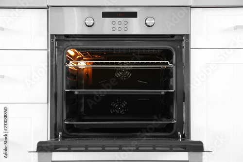 Open modern oven built in kitchen furniture