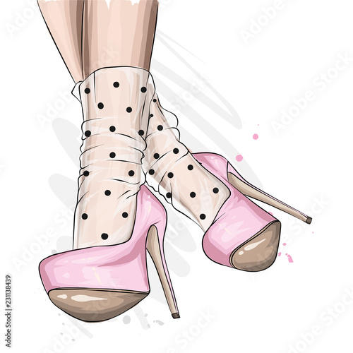 Female legs in stylish shoes with heels and lace socks Fototapet
