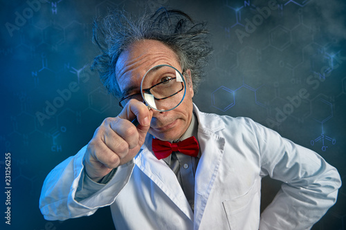 Funny scientist looking through a magnifying glass