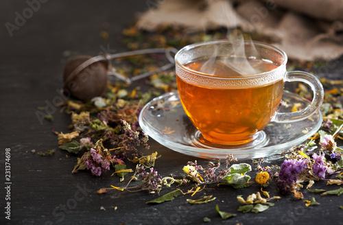 Cup of herbal tea with various herbs