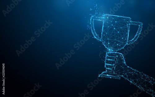 Fotografie, Obraz Hand holding trophy cup tophy form lines, triangles and particle style design