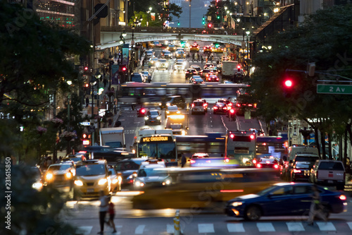 Fototapeta 42nd Street is crowded with the busy night lights of crosstown traffic through M