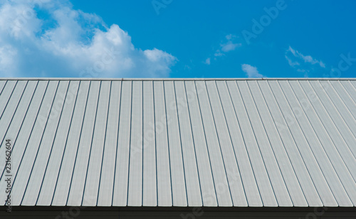 Fotografia Metal sheet for industrial roof and blue sky.